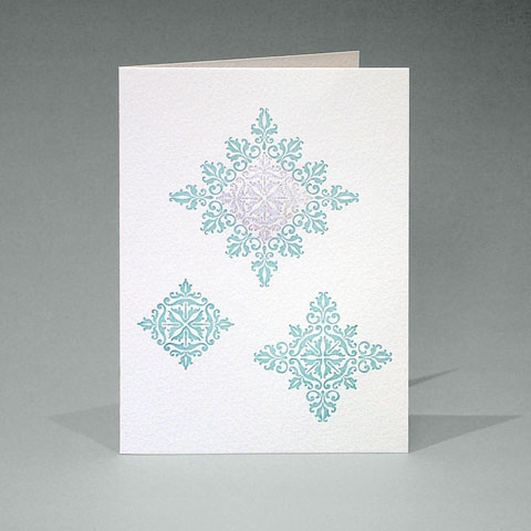 Floral ornament snowflake card in blue and silver