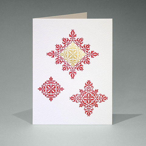 Floral ornament snowflake card in red and gold