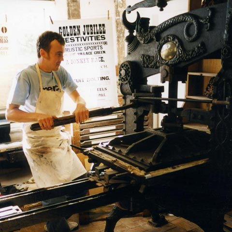 Justin Knopp printing on a 19th Century Columbian handpress.