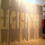 Nick Sherman standing with his 576 lines pica, or 8 feet wood type (image © Nick Sherman 2011)